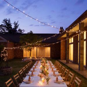 【アンドリュース】夕刻のパーティはキャンドルの優しい灯りでより幻想的に|星野リゾート 軽井沢ホテルブレストンコートの写真(1492932)
