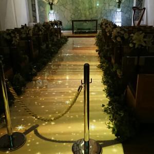 城壁に十字架。ライトアップのバージンロード。|494917さんのKKRホテル熊本の写真(619991)