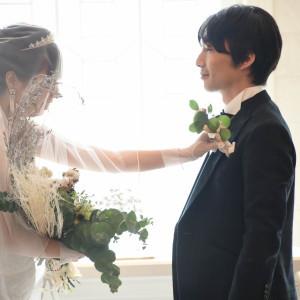 ブーケブートニアの儀式。花嫁からブートニアを新郎へ|495442さんのモルトン迎賓館 八戸の写真(692871)