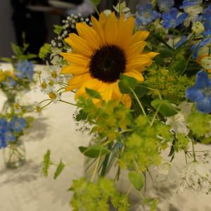 好きな向日葵を入れてもらいました。プラン内の装花です。|521879さんの旧軽井沢 キキョウ, キュリオ コレクション バイ ヒルトン(元:旧軽井沢ホテル)の写真(777516)